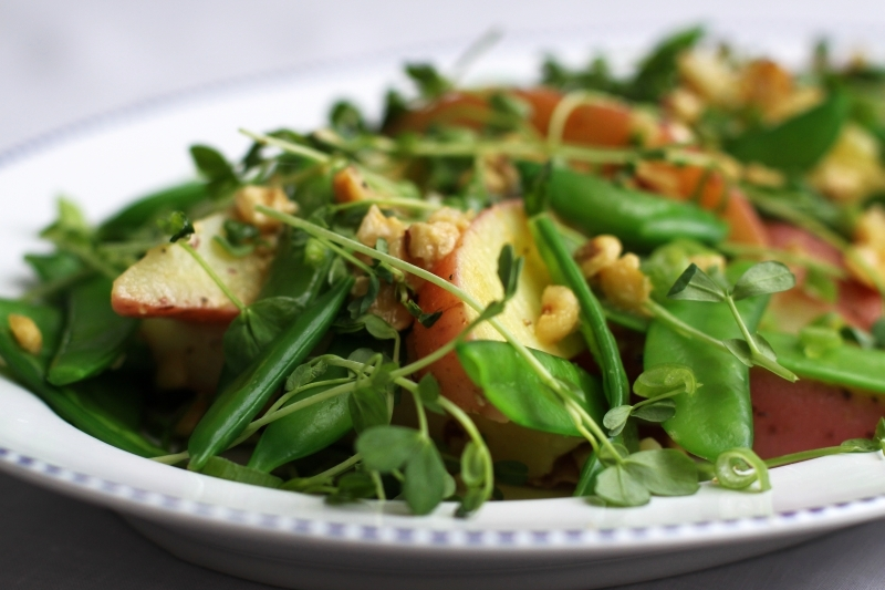 Potato and pea salad with hazelnut dressing